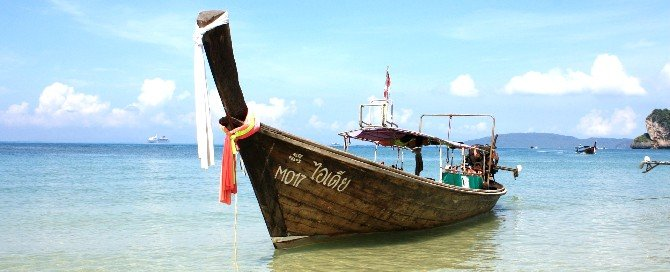 King Travel uses a wooden boat to transport passengers to the mainland